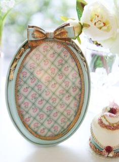 I love little frames topped with a bow!