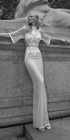 Lior Charchy 2017 Wedding Dress This mesh wedding dress is transparent, but since it's lined everywhere you need coverage,  it ends up being quite modest, really. Beautiful embroidery. Perfect for an summer wedding on the beach.