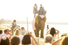 Who said that the Groom can't make an entrance as well? Make an impression by riding in on an Elephant. Faraway Beach Weddings, Thailand.