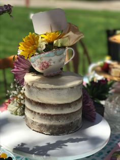 Naked carrot cake with cream cheese frosting and fresh flowers