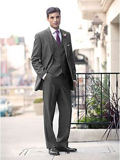 Grey three-piece, a bit darker than this.  Light blue shirts and gold ties?  Ivory shirts and gold ties?
