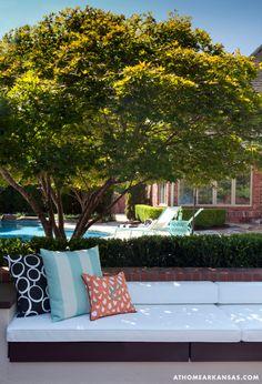 A Haute Outdoor Retreat | At Home Arkansas | March 2014 | Photographer: Nancy Nolan | Designer: Tobi Fairley #pool #boxwood #aqua #orange #blackandwhite