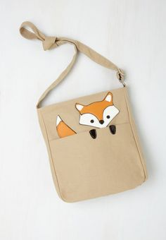 This little buddy peeking out from this little purse. | 21 Adorable Fox Products You Need In Your Life