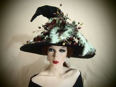 Weve made the base of this hat is made from velveteen and is adorned with beautiful burgundy and green plant and berries. This hat says sinister without being frilly. Perfect for that bad girl out there! WHY BUY OUR HATS?!?  Every hat we offer is completely hand made by myself and my husband. We start by hand selecting the finest materials to then craft into a base hat using traditional Milliners techniques. We then decorate each and every one into a unique work of art as unique as the Witch…
