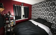 Live the 3 dark maroon walls with one black in white patterned wall. Very nice colors