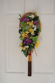 """tennis racquet """"wreath""""  I would use different flowers."""