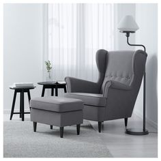 IKEA - STRANDMON, Wing chair, Nordvalla dark gray, , You can really loosen up and relax in comfort because the high back on this chair provides extra support for your neck.10-year limited warrranty. Read about the terms in the limited warranty brochure.