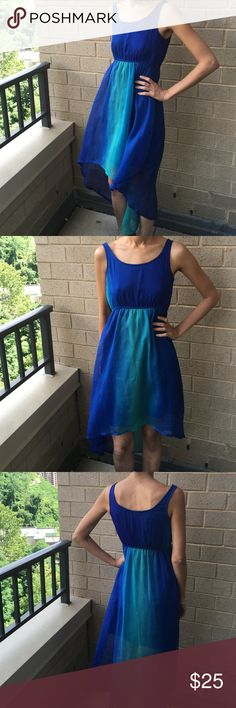 Shades of blue Absolutely gorgeous hi lo dress for the summer . Umpirre waist has elastic all around .dress is lined . Fabric is polyester . Used 2-3 times . Dresses High Low