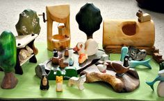 Some of our collection of wooden toy figures made by artists from etsy, Ostheimer, Buntspechte, Heartwood Arts, Georgian Wood Toys, and Kinderkram.