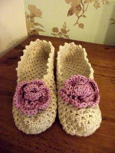 Crochet slippers with pink crochet flower