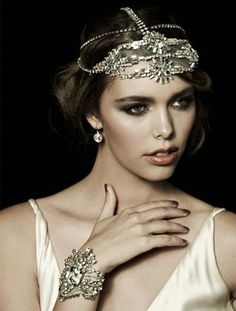 An Ornate Headpiece  A delicately hand-crafted crystal headpiece is luxuriously reminiscent of the 1920s (not to mention, it's the ultimate veil alternative). Pair it with a simple silk charmeuse gown, or take your beaded dress to new heights and channel your inner flapper (Daisy would be proud).  Headpiece by Johanna Johnson