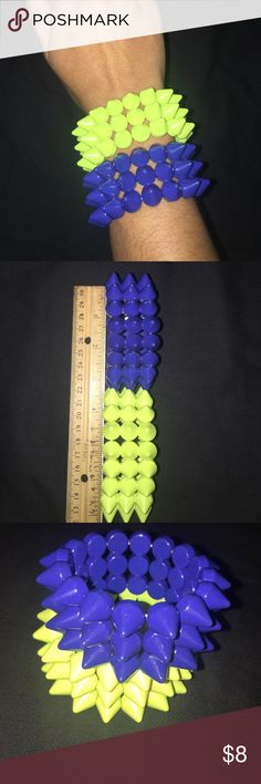 Two Neon Spike Forever 21 Purple Yellow Bracelets Two stretchy neon yellow and purple plastic spike bracelets.  Worn once. Forever 21 Jewelry Bracelets