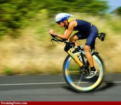 Unicycle racer - looks like surefire way to a face-plant if I ever saw one!