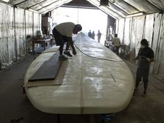Boat builders work on the world's largest surfboard on May 12 at Westerly Marine in Santa Ana, Calif.  Ed Crisostomo, The Orange County Registe, via AP