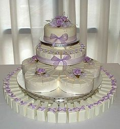 Cake Slice Favor Boxes | Wonderful display of Cake Slice Boxes. Boxes available at http://www ...