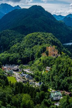 Hohenschwangau Castle and village in Bavaria, Germany  - this castle is where King Ludwig lived while the Neuschwanstein castle was being built. the two castles are very close to each other.