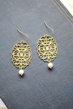 Gold and Pearls -delicate dangle earrings with an oriental touch - white pearls and gold filigree like gold metal work.