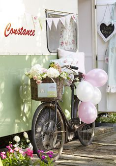Love the bicycle. Maybe have a decorated bike outside the entrance doors depending on time of day.