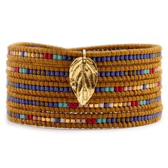 Chan Luu - Blue Mix Charm Wrap Bracelet on Henna Leather, $205.00 (http://www.chanluu.com/wrap-bracelets/blue-mix-charm-wrap-bracelet-on-henna-leather/)