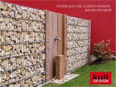 Wasserhahn perfekt in Wand integriert. Wasserstelle im Garten