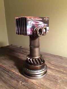 Custom hot rod business card holder made from repurposed engine and car parts.