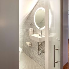Keep your small bathroom feeling open and bright instead of dark and cluttered with these modern bathroom lighting ideas and tips. Modern Bathroom Lighting, Bathroom Light Fixtures, Modern Lighting, Bathroom Modern, Lighting Concepts, Lighting Ideas, Small Toilet, Bathroom Interior, Bathroom Ideas