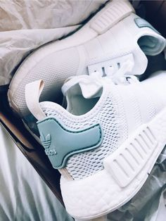 best website e912a 9c391 White adidas running shoes with matte teal back