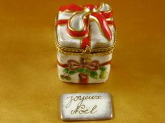 Red ribbon christmas box w/plaque - Limoges Boxes and Figurines - Limoges Factory Co. Christmas Themes, Christmas Holidays, Merry Christmas, Holiday Mood, Christmas Figurines, Mid Century Style, Red Ribbon, Chain Pendants, Trinket Boxes