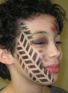 What a great face painting idea for a creative costume (by Funtastical Faces).