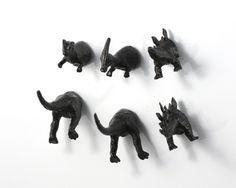 6 piece Dinosaur Magnet Set - Jet Black Dinosaurs - Kitsch gift. $17.50, via Etsy.