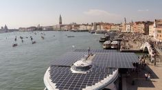 Contrasts in Venice, solar energy versus old city.