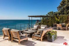 Gourmet island kitchen, & breakfast bar & nook; pocket doors open to a resort-style outdoor entertainers space w/multiple sitting/dining areas, & a covered lounging area w/modern fire pit, all w/spectacular ocean & sunset views.
