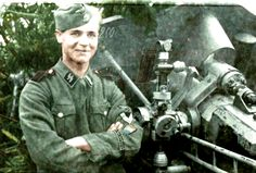 Young ϟϟ from Netherland, ranked as Rottenführer in front of FH18 Howitzer 105mm, during the battle of Narva, in Estonia February-August. 1944.