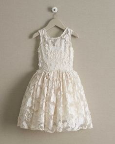 Girls Lace Party Dress - A stunning dress that will inspire compliments wherever she goes. Along with its soft color, you'll see embroidered lace and an illusion neckline on the fitted bodice.