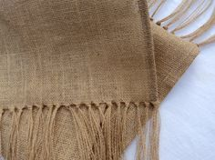 Burlap table runner with fringe.  This burlap table runner has such a beautiful and elegant look.  It would be gorgeous on your dining table or entry way table.  The runner is 14 wide and made from natural burlap which is chemical and odor free.  This runner is professionally finished with hems and hand knotted 7 fringe.  I have some standard sizes for you to choose from...these sizes are total length of the runner from fringe to fringe.  I would be happy to make the runner for you in any…