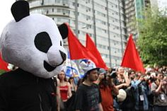 """A self-described anarcho-pacifist, he tries to create a buffer between police and students to avoid violence """"without betraying [the students'] struggle or co-opting their discourse"""". (Anarchopanda - Wikipedia, the free encyclopedia.)"""