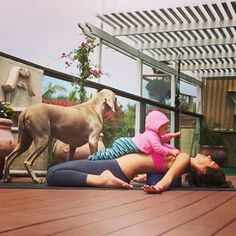 And stay centered while being the family's center. | 35 Mom And Baby Yoga Duos To Lower Your Heart Rate