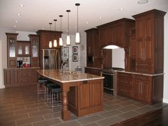 Cabinets: Maple - Brazil Nut with Black Glaze / Countertops: Granite - Not supplied from Creative Kitchens