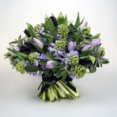 Deep Plum Purple Tulips, Lavender Tulips, Lavender Hyacinth Buds, Several Varieties Of Greenery and Foliage Wedding Bouquet All Flowers, Bridal Flowers, Spring Flowers, Beautiful Flowers, Spring Bouquet, Deco Floral, Arte Floral, Beautiful Flower Arrangements, Floral Arrangements