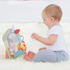 The playful Skip Hop Treetop Friends Activity Mirror helps with that developmental stage of self-recognition. Getting to know that cute face in the mirror is important and this mirror helps them do that. Shaped like a window, there is a field of 'grass' ribbon at the bottom and an owl rattle and squeaky bird which will attach anywhere around the mirror. The mirror will stand upright, fold flat or attached to anything that has the ability to attach the integrated loop too.