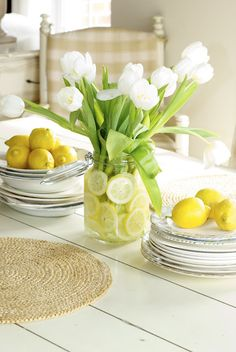 lemons and tulips on plank table top