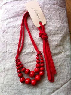 Color Pop Necklace. Graduated wooden beads with ties of cut tee shirt fabric.
