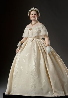This is listed as 1863. Mary Lincoln would actually have been in mourning for Willie in 1863 and not worn something so cheerful. This is an excellent representation of Mary's taste for the fashionable style in Godeys Ladies Magazine.