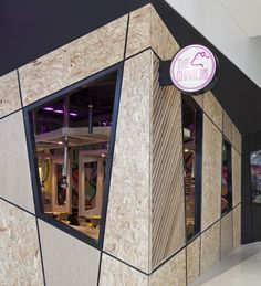 The neon magenta stencilled blade signs located at the shopfront immediately attracts the attention of the customer, this is also carried inside the ceiling of the restaurant creating a funky atmosphere.