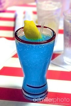 Electric Lemonade - 7up, sour mix, vodka, lemon, and blue curacao. Sounds good!