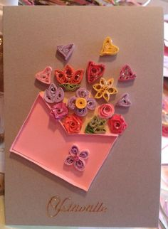Valentine's card, envelope full of flowers and hearts by quilling