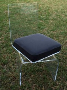 Vintage lucite swivel chair $385