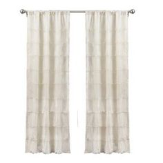 Ruffled faux silk curtain panel.  Product: Window panel and tiebackConstruction Material: 100% PolyesterColor: IvoryFeatures:  Rod pocketLayers of sheer voile Dimensions: 84 H x 42 WCleaning and Care: Dry clean only