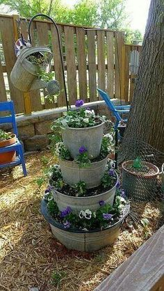 Recycle galvanized pots and watering can into planters PHOTO ONLY