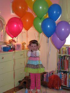 surprise balloon rainbow on birthday morning